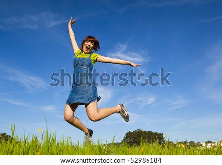 Happy young woman jumping and enjoying the spring on a beautiful day