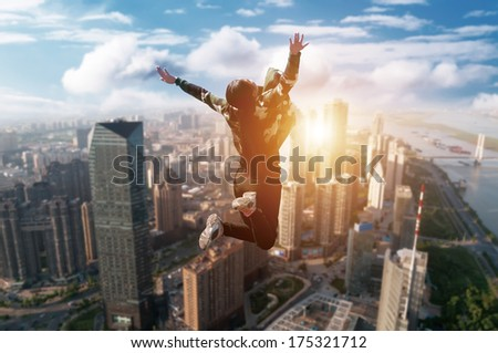 Happy Young Woman Jumping over blue sky. Beauty Girl Having Fun Outdoor. Freedom Concept. Nature.