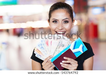 happy young woman just won a trip abroad - stock photo