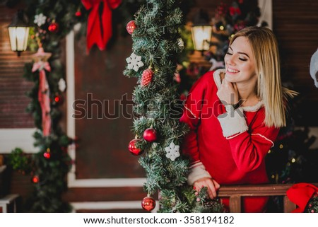 Happy young woman laughing. In the background the Christmas decorations - stock photo