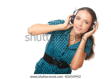 happy young woman listening music in big headphones and looking at camera on white background - stock photo