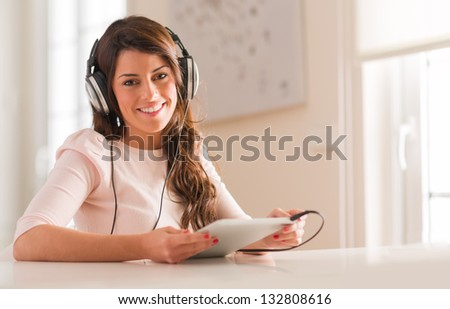 Happy Young Woman Listening To Music On Headphones - stock photo