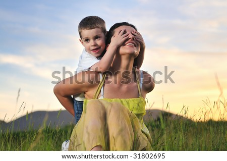 happy young woman mother play and outdoor with beautiful child