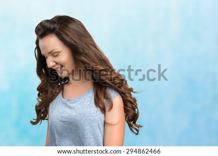 Happy young woman on blue background