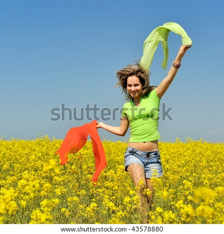 happy young woman on field in summer