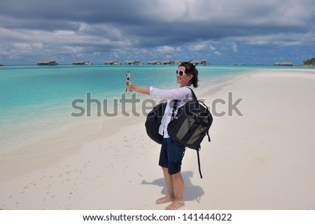 happy young woman on summer vacation on beautiful tropical beach have fun and relax