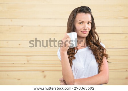 Happy young woman on wooden background