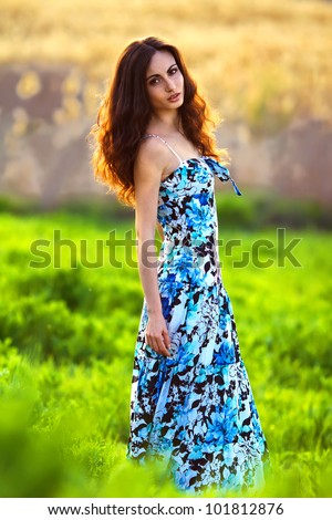 happy young woman outdoors in the field - stock photo