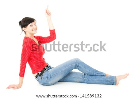 happy young woman poining up, full lenght, white background - stock photo