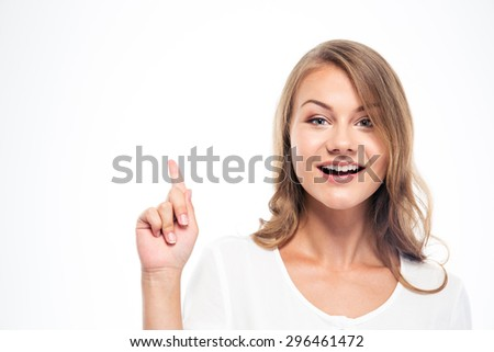 Happy young woman pointing finger up and looking at camera isolated on a white background. I having idea! - stock photo