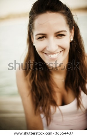 Happy young woman portrait. Shallow DOF