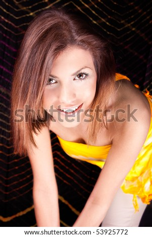 Happy young woman posing and smile, studio shot