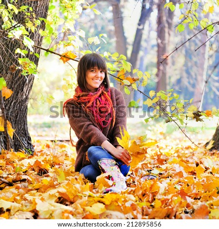 Happy young woman rest on the nature, autumn outdoor. - stock photo