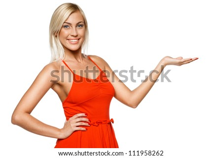 Happy young woman showing a product - empty copy space on the open hand palm, over white background