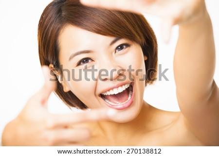 happy young Woman showing frame finger sign  - stock photo