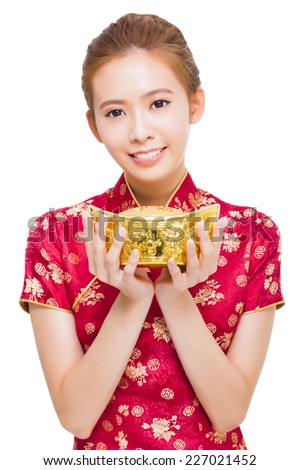 happy young woman showing  gold for chinese new year - stock photo