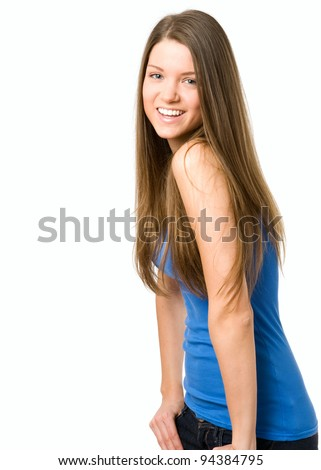 Happy young woman smiling at camera. Hands in jeans - stock photo