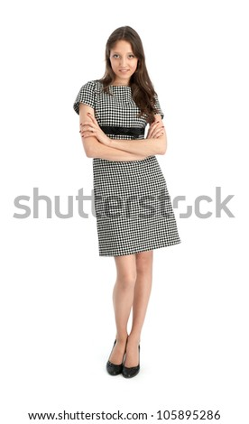 happy young woman standing with folded hands on white background - stock photo
