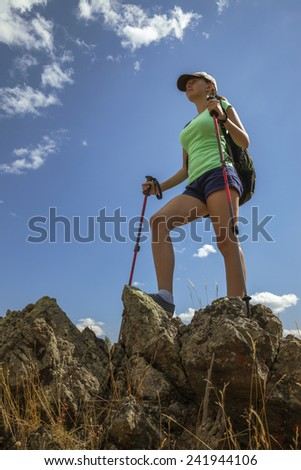 happy young woman tourist on the mountain - stock photo
