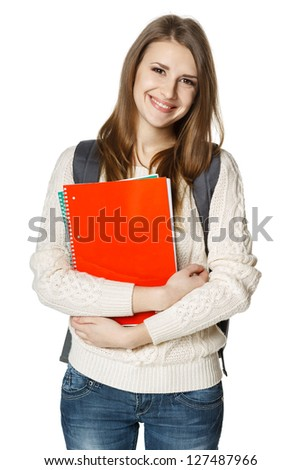 Happy young woman wearing a backpack and holding notebooks ready to go to class, over white background