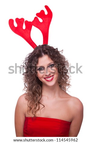 happy young woman wearing reindeer horns, on white background, studio shot - stock photo