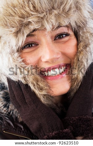 Happy young woman with a beautiful smile. Studio shot as a wintry portrait.