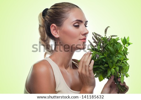 Happy young woman with a bundle of fresh mint.  Concept vegetarian dieting - healthy food - stock photo