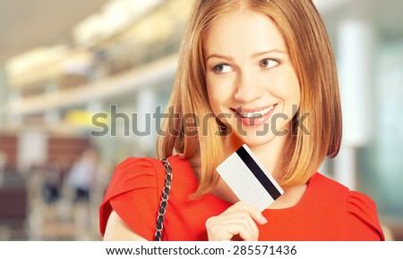 happy young woman with a credit card went on shopping - stock photo