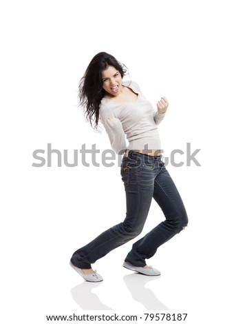 Happy young woman with arms up after wining something, isolated against a white background