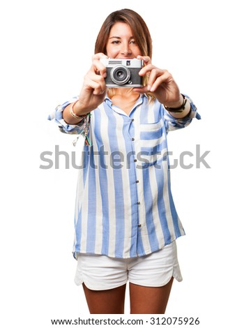 happy young woman with camera