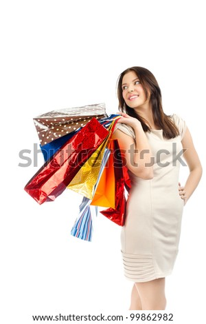 Happy young woman with colorful shopping bags. Isolated on white background - stock photo