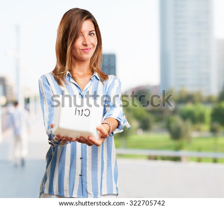 happy young woman with control key