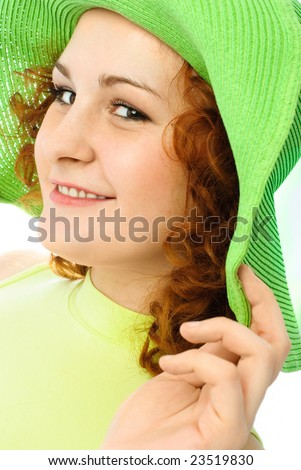happy young woman with ginger hair wearing a green hat