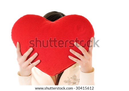 happy young woman with heart isolated on white