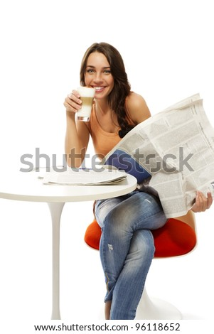 happy young woman with latte macchiato coffee and a newspaper on white background - stock photo