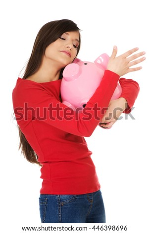 Happy young woman with piggybank. - stock photo