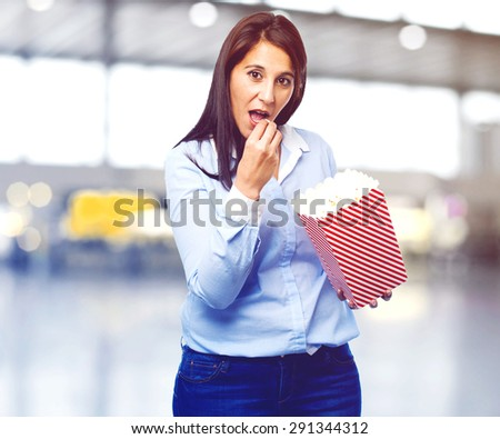 happy young woman with popcorn - stock photo