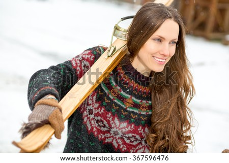 Happy young woman with retro ski outdoors portrait - stock photo