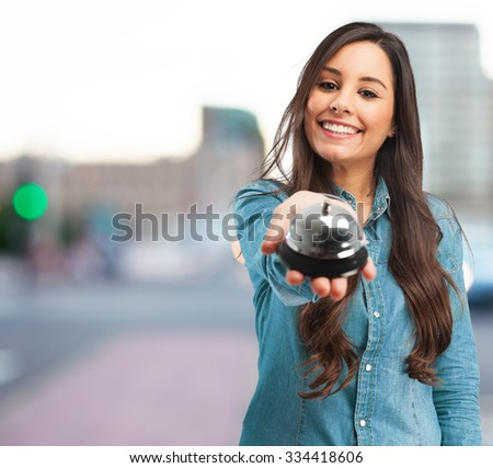 happy young woman with ring bell - stock photo