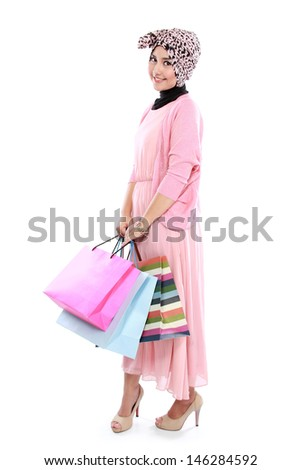 Happy young woman with shopping bag isolated over white background