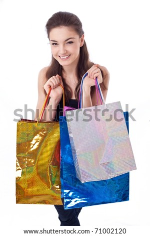 Happy young woman with shopping bags.Isolated on a white background - stock photo