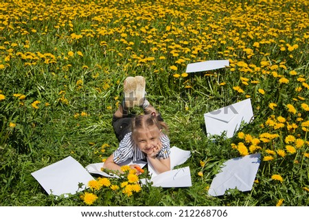Happy Young  Woman Writing i and Smiling in summer Garden. - stock photo