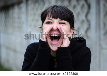 Happy young woman, yelling outside