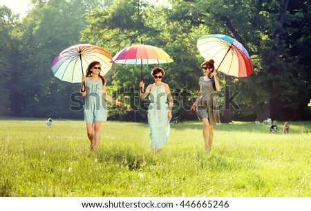 Happy young women having fun in park