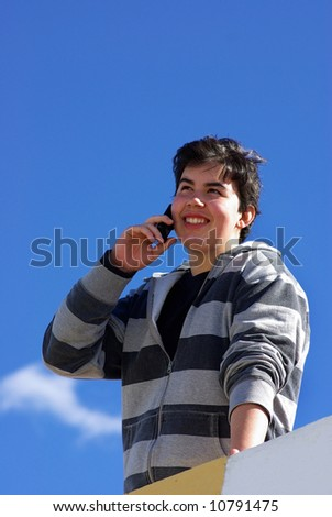 Happy  youngster speaks to the mobile telephone.