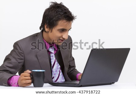 happyness businessman on a laptop cheers about something he sees. - stock photo