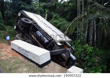 HAPUTALE; SRI LANKA - JANUARY 22: Road accident in Haputale. Traffic accident January 22, 2014 in Haputale, Sri Lanka.A truck was going down at hight speed and loose control on a curve - stock photo