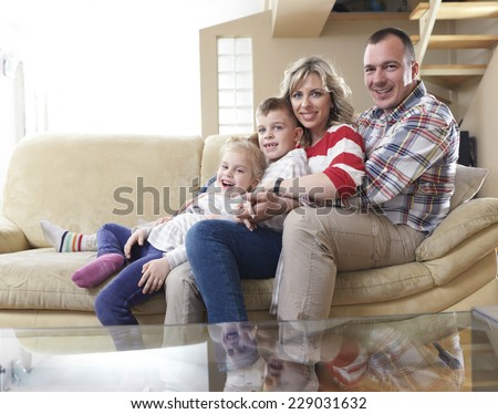hapy young family have fun  with their children at modern living room home indoors
