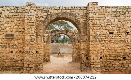 HARAR, ETHIOPIA - JULY 26,2014 - Buda Gate, also known as Badro bari, Karra Budawa, and Hakim Gate, is one of the entrances to Jugol, the fortified historic walled city on UNESCO World Heritage List. - stock photo