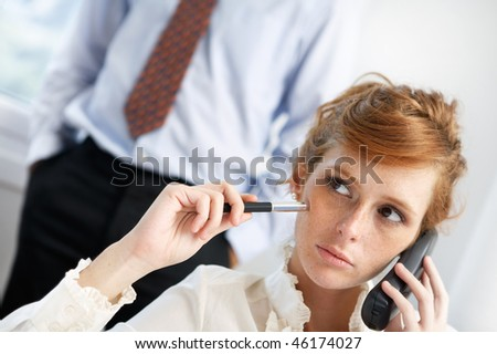 harassing a coworker - stock photo